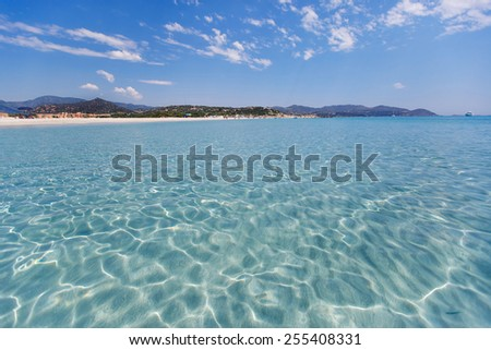 Panorama of idyllic beach with white sand and turquoise water - stock photo