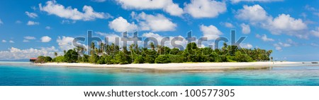 Panorama of idyllic Mantabuan island in Malaysia - stock photo
