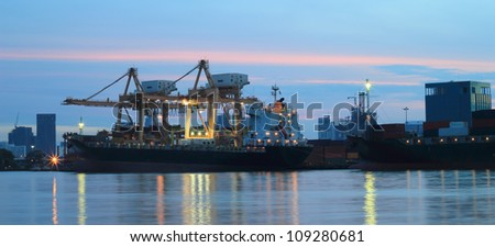Panorama of Industrial Container Cargo freight ship with working crane for Logistic Import Export