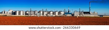 Panorama of industry plant with store buildings at sunny day time - stock photo