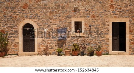 Panorama of inner court of monastery Toplou, Crete, Greece  - stock photo