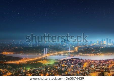 Panorama of Istanbul and Bosphorus bridge at night, Istanbul, Turkey - stock photo