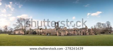 Panorama of Kirkstall Abbey's Ruins in Leeds, UK - stock photo