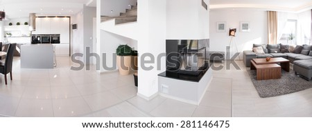 Panorama of kitchen and living room in exclusive residence - stock photo