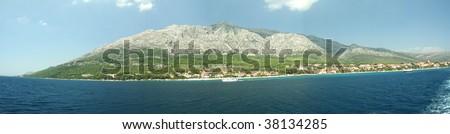 Panorama of Korcula Mountain on the side of the sea, Croatia - stock photo