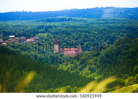 Panorama of Krivoklat castle in the Czech republic woods and hills