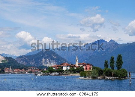 Panorama of Lake Maggiore and Fishermen Island with Alps mountains in background, Piedmont, Italy - stock photo