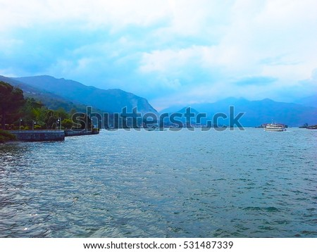 Panorama of Lake Maggiore and island Isola Bella with Alps mountains in background, Piedmont, Italy