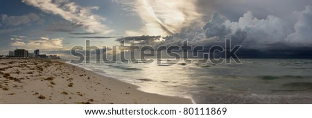 Panorama of large storm approaching Miami Beach during sunrise - stock photo
