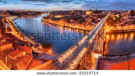 Panorama of lighted  famous bridge Ponte dom Luis above  Old town Porto and  river Duoro at night, Portugal - stock photo