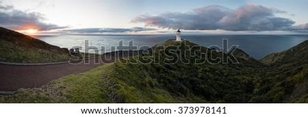 Panorama of Lighthouse Cape Reinga on the North Island of New Zealand at dusk - stock photo