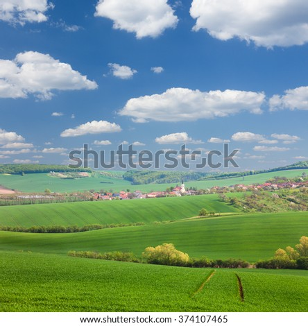 Panorama of  Little town on the green hills, blue sky, beautiful buildings and nature, traditional architecture, summer vacation concept, Europe, Czech Republic - stock photo