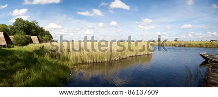 Panorama of lodge facing the river and the bush in Moremi Game Reserve, Botswana. - stock photo