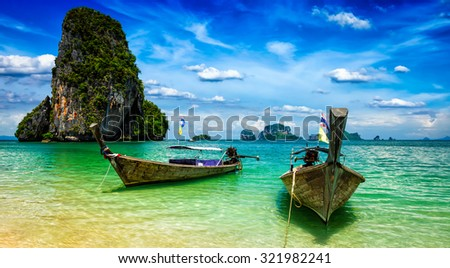 Panorama of long tail boats on tropical beach (Pranang beach), Krabi, Thailand
