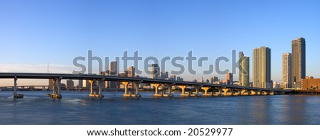 Panorama of MacArthur Causeway, Harbor Bridges and Miami Bayfront Skyline at Dawn - stock photo