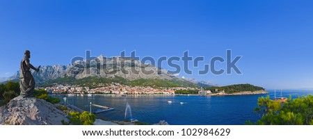 Panorama of Makarska and statue of St. Peter at Croatia - travel background