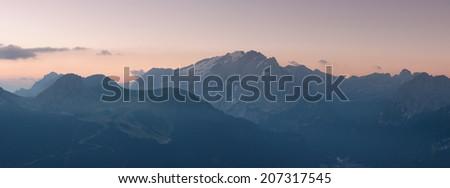 Panorama of Marmolada mountains ridge at sunrise, Val di Fassa, Italian Dolomites - stock photo