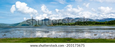 Panorama of medieval Stalker Castle on small island in Loch Linnhe, Argyll in the Scottish Highlands - stock photo