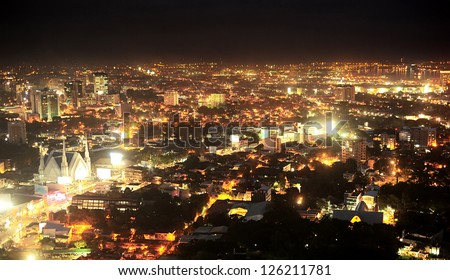 Panorama of Metro Cebu at night. Cebu is the Philippines second most significant metropolitan centre and main domestic shipping port. - stock photo