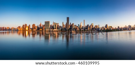 Panorama of Midtown Manhattan with reflections during Sunrise