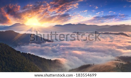 Panorama of misty morning in the mountains in summer - stock photo