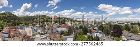 Panorama of Moedling (Lower Austria) with his famous aqueduct Built in the 18th century with Vienna in the background. The aqueduct is part of the First Viennese mountain spring water supply line. - stock photo