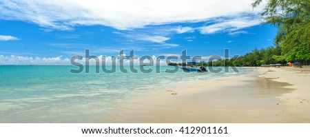 Panorama of Mont Choisy beach in Mauritius with a speed boat in the background  - stock photo
