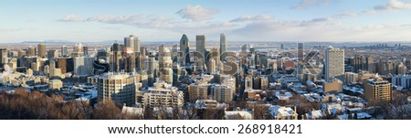 Panorama of Montreal in winter, as seen from Mont Royal. Downtown district with St Lawrence River in the background. early evening light. - stock photo