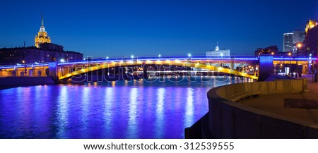 panorama of Moscow city with lighting Smolensky bridge and river at summer evening in Russia - stock photo