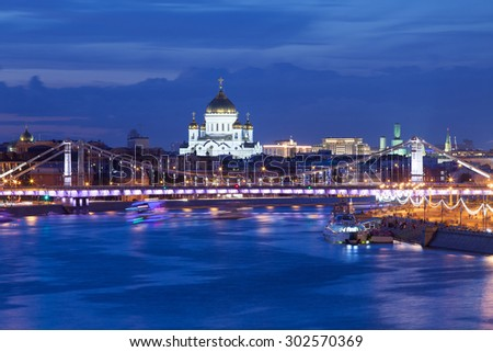 panorama of Moscow with view the Crimean bridge and Christ the Saviour Cathedral at summer evening.  long exposure and blurred motion - stock photo