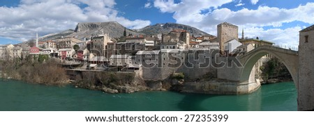 Panorama of Mostar old town east side with Old Bridge on a sunny winter day.