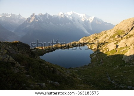 Panorama of mountain lake in Alps near Mont Blanc France - stock photo