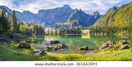 panorama of mountain lake in the Julian Alps,Laghi di Fusine - stock photo