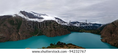 Panorama of mountain landscape with turquoise Phoksundo lake in Shey Phoksundo national park, Dolpo area, Nepal - stock photo