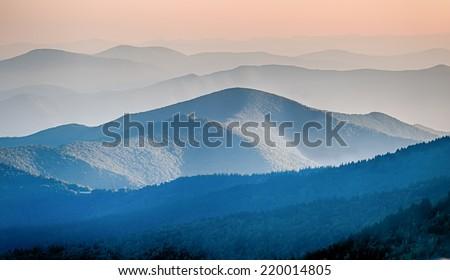 Panorama  of mountain ridges silhouettes - stock photo