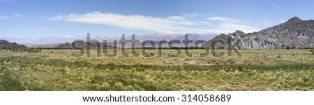 Panorama of mountains, arid wild landscape and blue sky on the famous Ruta 40 (Route 40), within Calchaqui Valleys in Salta Province. Argentina - stock photo