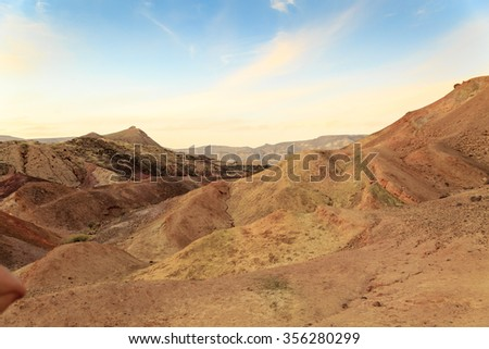 Panorama of mountains in the Big Crater (HaMakhtesh HaGadol) in Israel at sunset - stock photo