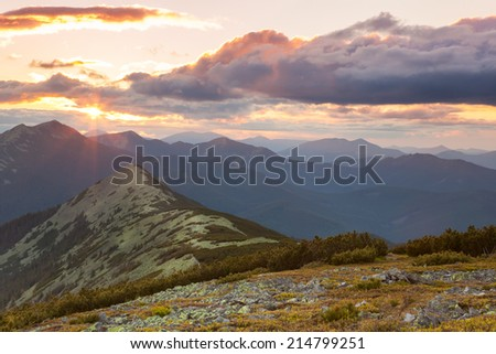 Panorama of Mountains -  sunset time. Beautiful peaks, clouds and sunlight. Carpathians