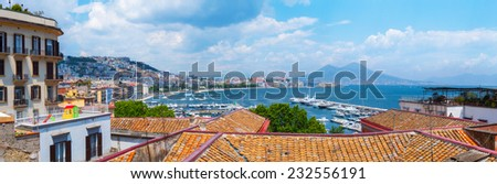 Panorama of Naples, view of the port in the Gulf of Naples and Mount Vesuvius. Authentic Mediterranean terracotta tiled roof. The province of Campania. Italy. - stock photo