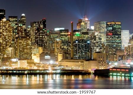 Panorama of New York city at nighttime - stock photo