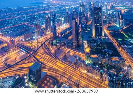 Panorama of night Dubai during sunset - stock photo
