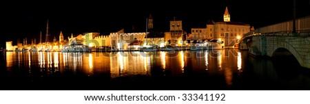 Panorama of night harbour of Trogir (Croatia) - stock photo