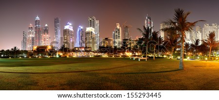 Panorama of night illumination of the luxury hotel, Dubai, UAE - stock photo