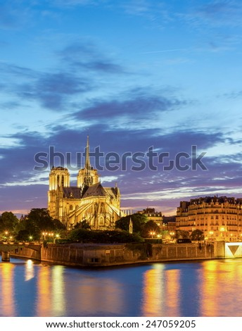Panorama of Notre Dame Cathedral with Paris cityscape at dusk, France - stock photo