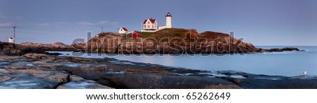 Panorama of Nubble Lighthouse at sunset, Cape Neddick, Maine, USA - stock photo