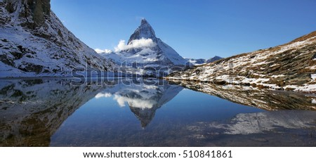 Panorama of of Riffelsee with Matterhorn reflection, Switzerland