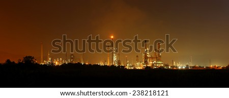Panorama of oil refinery at sunrise - stock photo
