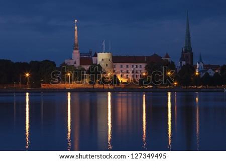 Panorama of old Riga at night. Latvia - stock photo