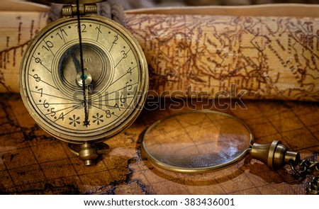 Panorama of Old vintage retro compass on ancient world map. Vintage still life. Travel geography navigation concept background. - stock photo