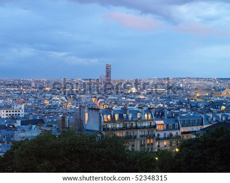 Panorama of Paris by night from the Sacre Coeur of Montmartre. - stock photo